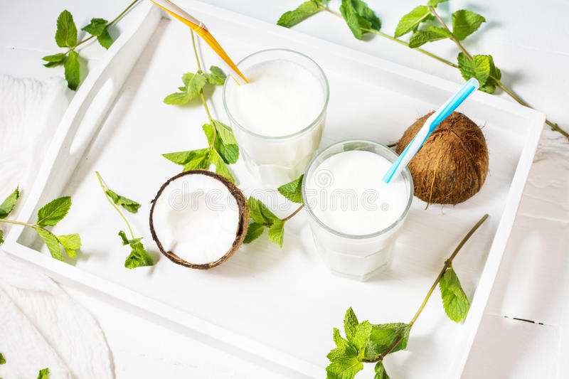Coconut vegan milk coctail in glass on wooden background stock photo