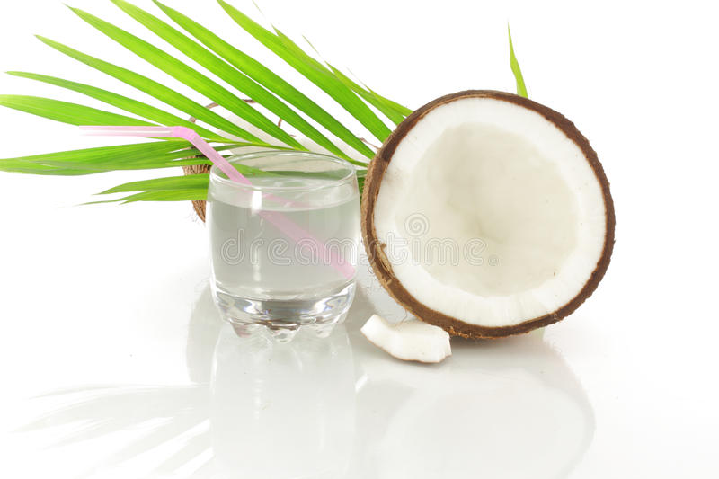 Coconut water and cut white coconut stock images