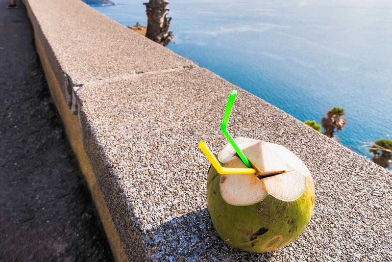 Coconut water drink placed on the edge of the wall royalty free stock image