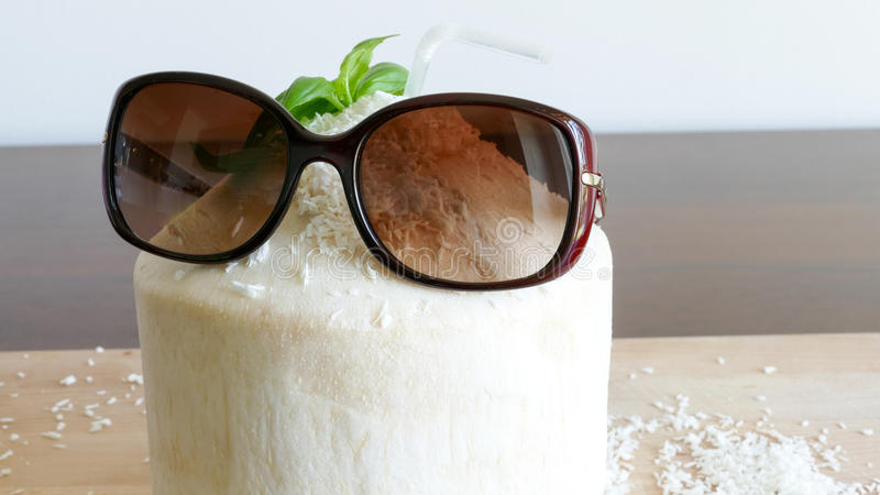 Coconut water drink with sunglasses - summer concept stock images