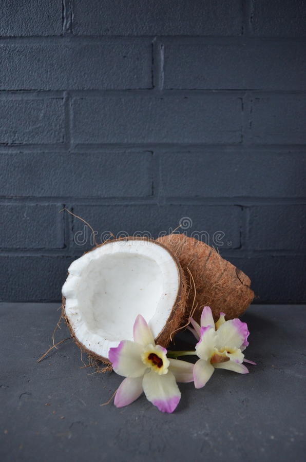 Download Coconuts With Mint Leaves Orhid Flowers, On Dark Background. Copy Space. Stock Photo - Image: 83701500