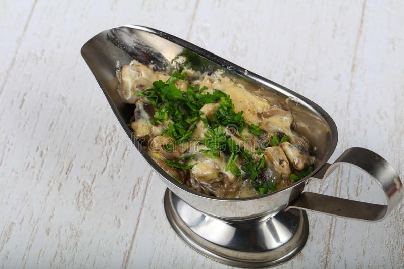 Cocotte julienne with mushroom stock photography