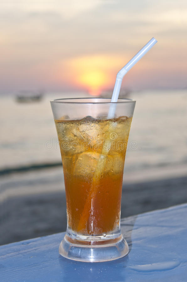 Coctail on sunset beach in Asia royalty free stock image