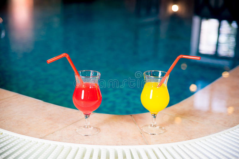 Coctails by a pool stock photos