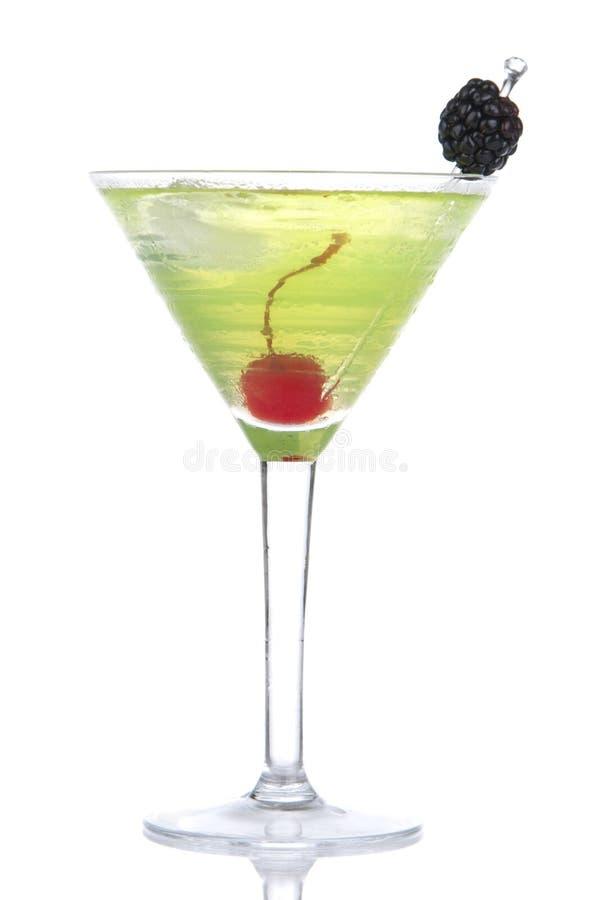 Coctel cosmopolita de martini del alcohol amarillo verde foto de archivo