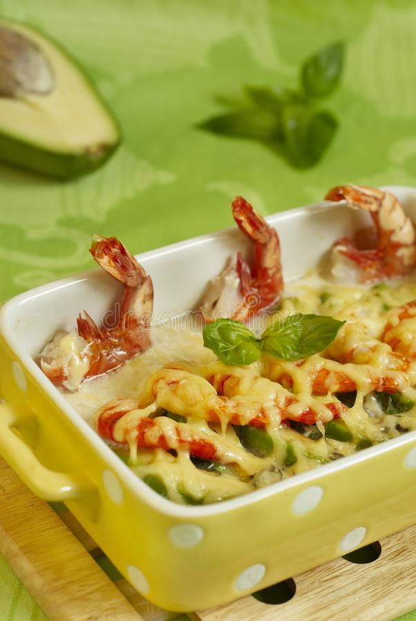 Cod baked with shrimps and avocado stock images