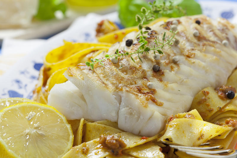 Cod Fillet Loin. Grilled Cod Filet Loin with italian noodles and pesto stock images