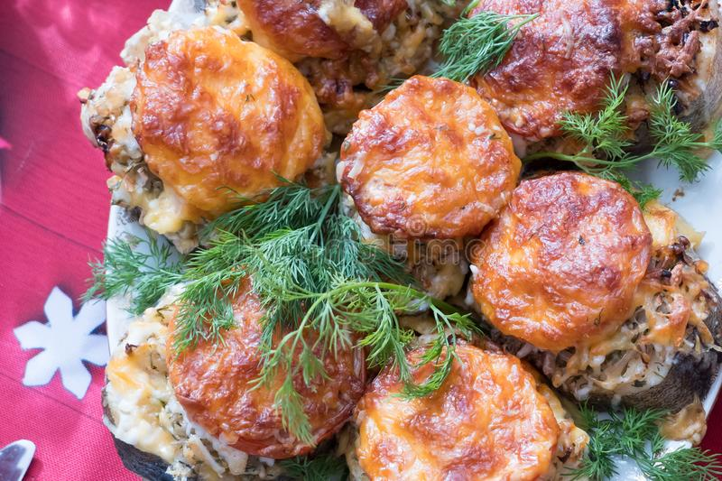 Cod fish baked with tomatoes and cheese. Top view stock photos