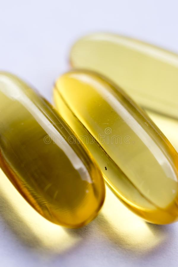 Cod fish liver oil capsules royalty free stock photo