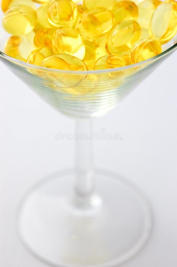 Cod liver oil capsules martini stock photos