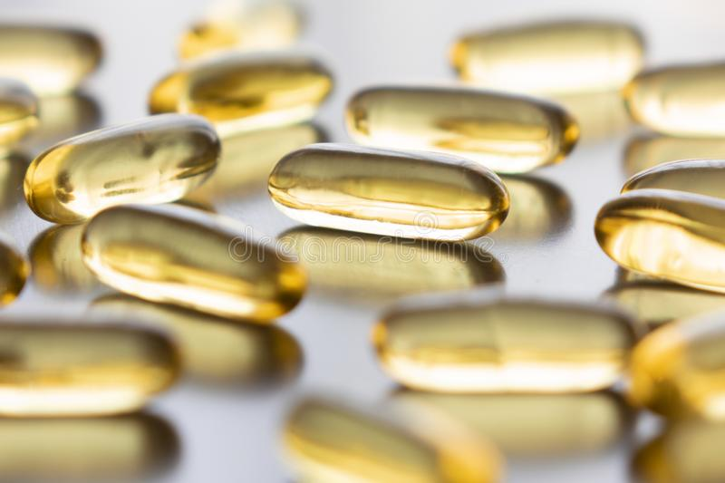 Cod liver oil omega 3 gel capsules isolated on pastel background stock image