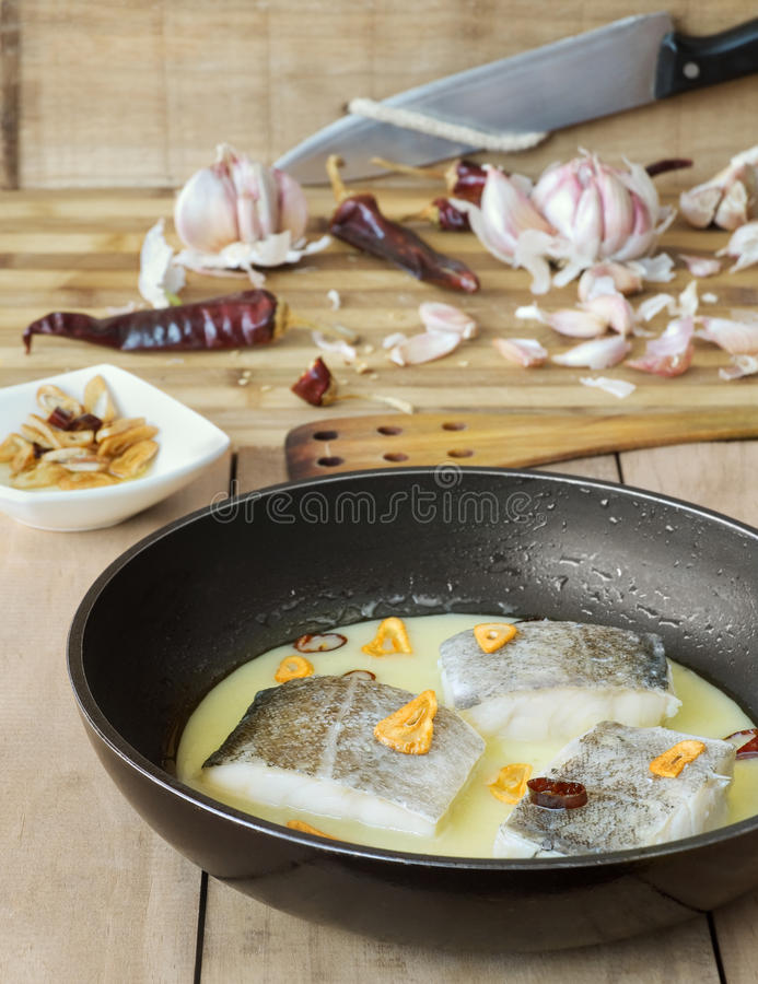 Cod with Pil Pil Sauce, Basque cookery. Cod with pil-pil sauce (Bacalao al pil pil), Basque cookery royalty free stock photo