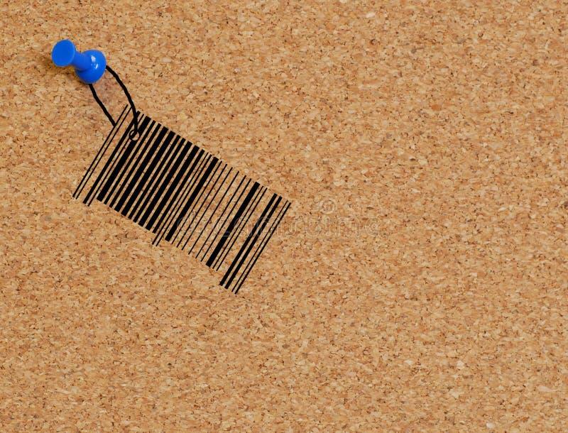 Code barres cloué au corkboard images stock