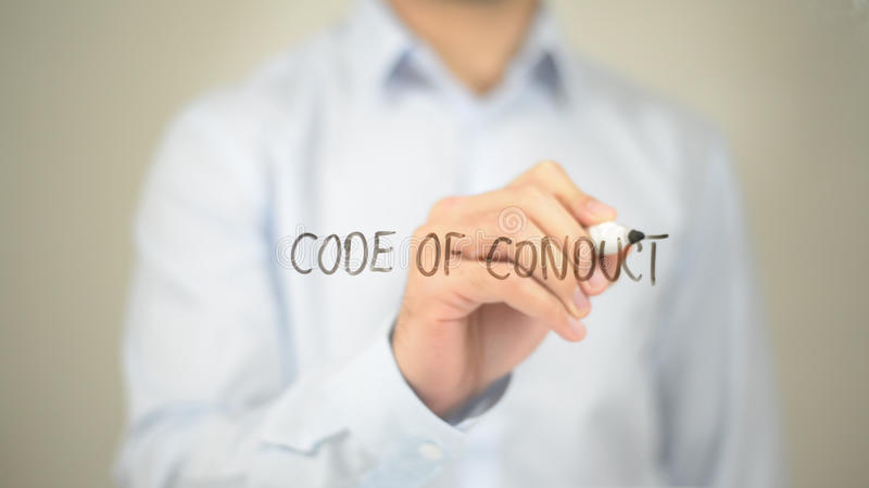 Code of Conduct, Man writing on transparent screen royalty free stock photo