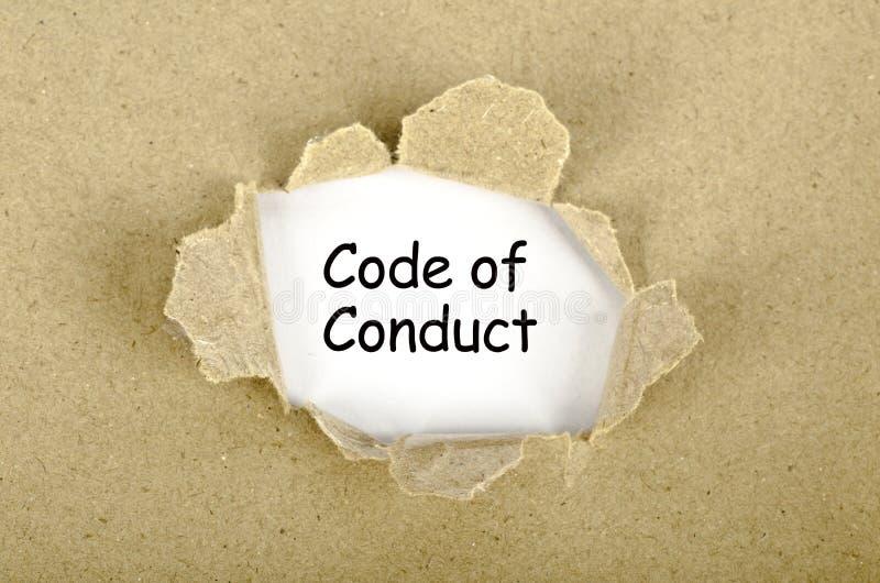 Code de conduite le mot écrit sur le papier déchiré illustration libre de droits