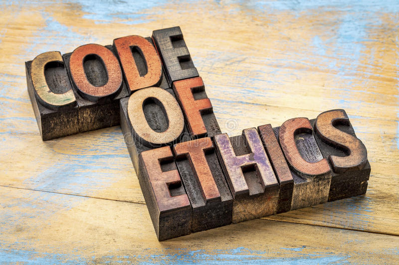 Code of ethics bannert in letterpress wood type. Code of ethics banner - text in letterpress wood type printing blocks stained by inks stock photography