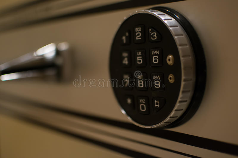 Code lock on a safe door royalty free stock image