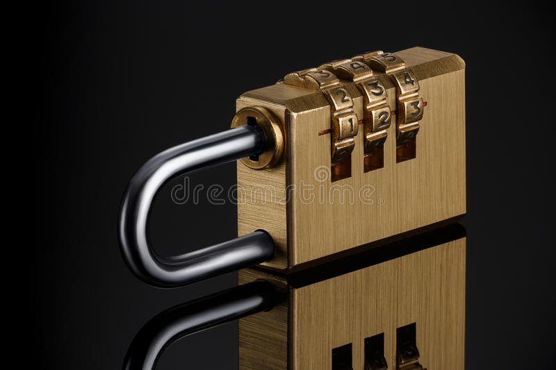 Code padlock. The metal combination padlock on a black background royalty free stock images
