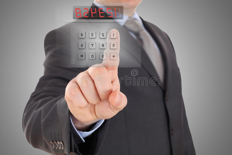 Code of security alarm system. Businessman is setting code of security alarm system royalty free stock image