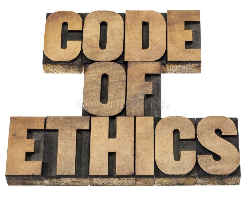 Code van ethiek in houten type stock afbeeldingen