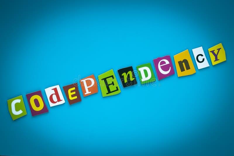 Codependency - woord op blauwe achtergrond van kleurrijke brieven Abstracte kaart met een inschrijving Tekst, krantekop, titel, r stock illustratie