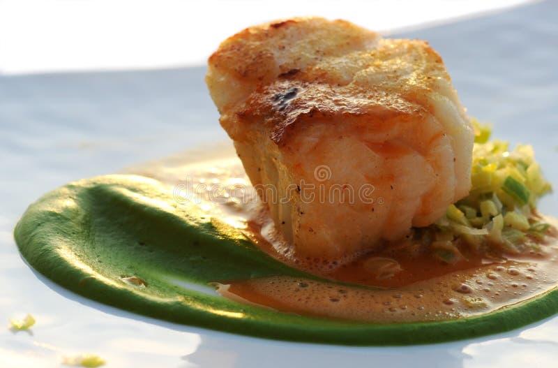 Codfish with leek brunoise stock images