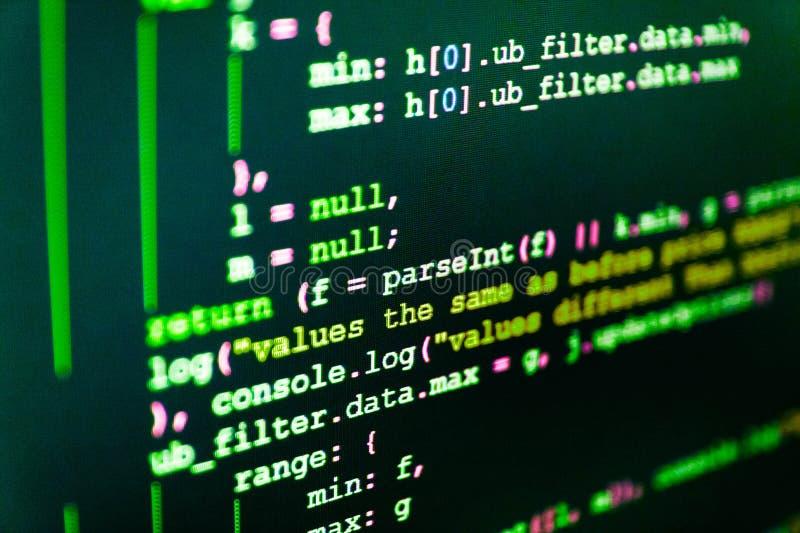 Codificación de las TIC en la pantalla de monitor Programación de Python fotos de archivo libres de regalías