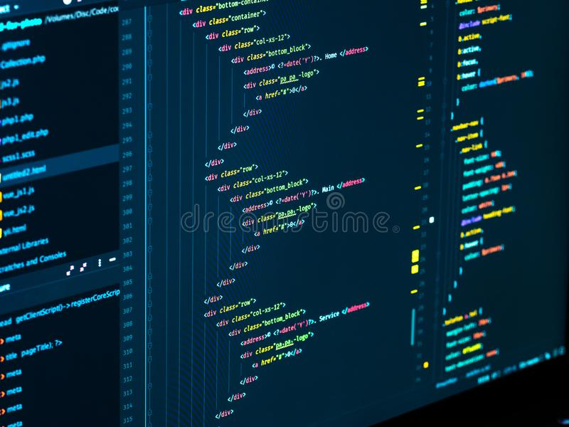 Coding html and css in IDE, macro. Web development. Software source code royalty free stock photos