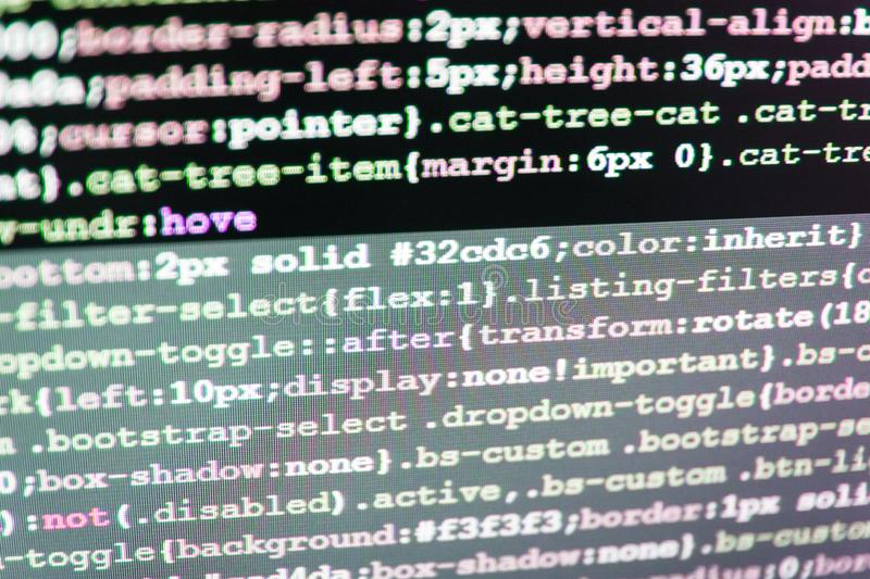 IT coding on monitor screen. Big data database app. HTML markup language closeup. Computer science lesson. Closeup of Java Script stock images