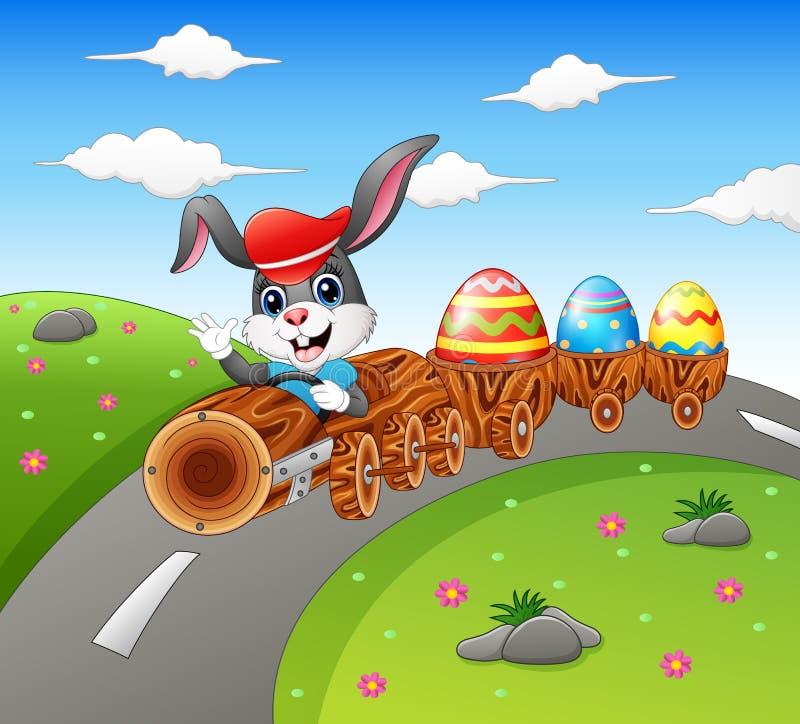 Coelhinho da Páscoa feliz que conduz ovos da páscoa levando de um trem da madeira ilustração do vetor