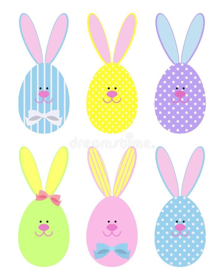 Coelhinhos da Páscoa decorativos Ajuste dos ovos da páscoa sob a forma dos coelhos ilustração royalty free