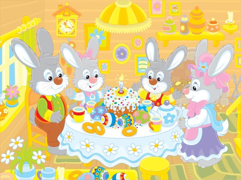 Coelhinhos da Páscoa na tabela festiva ilustração stock