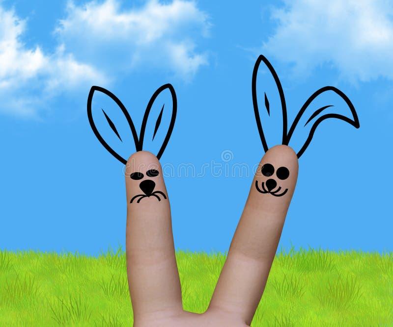 Coelhos engraçados do dedo da Páscoa fotografia de stock royalty free
