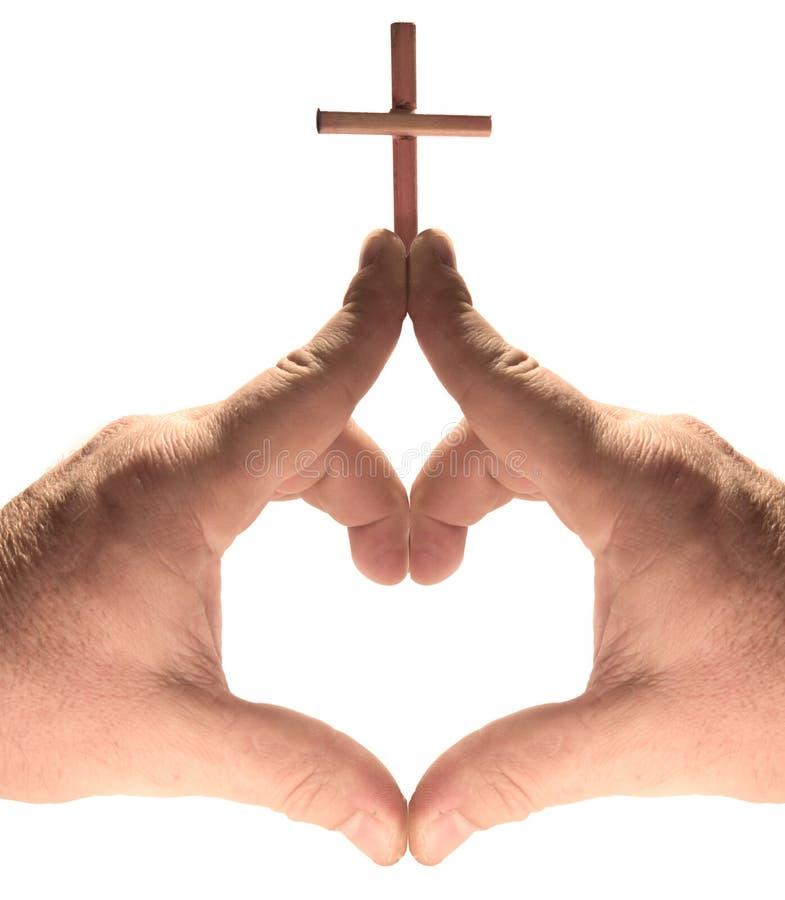 Coeur, église, mains en travers d'isolement sur le blanc image stock