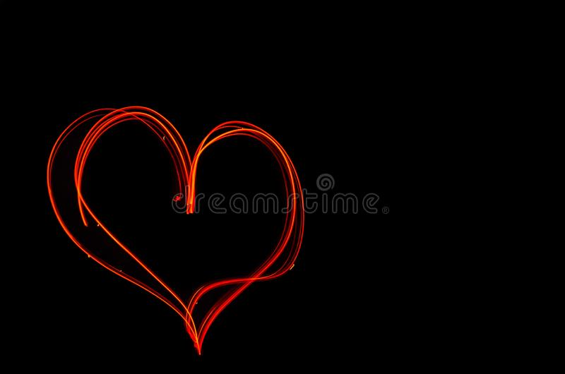 Coeur ardent sur la longue exposition la nuit Texture floue illustration stock