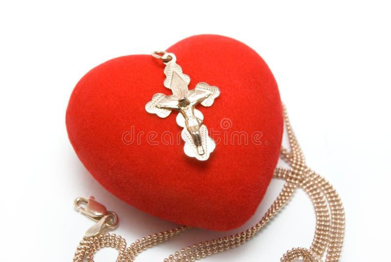 Coeur avec une croix photographie stock libre de droits