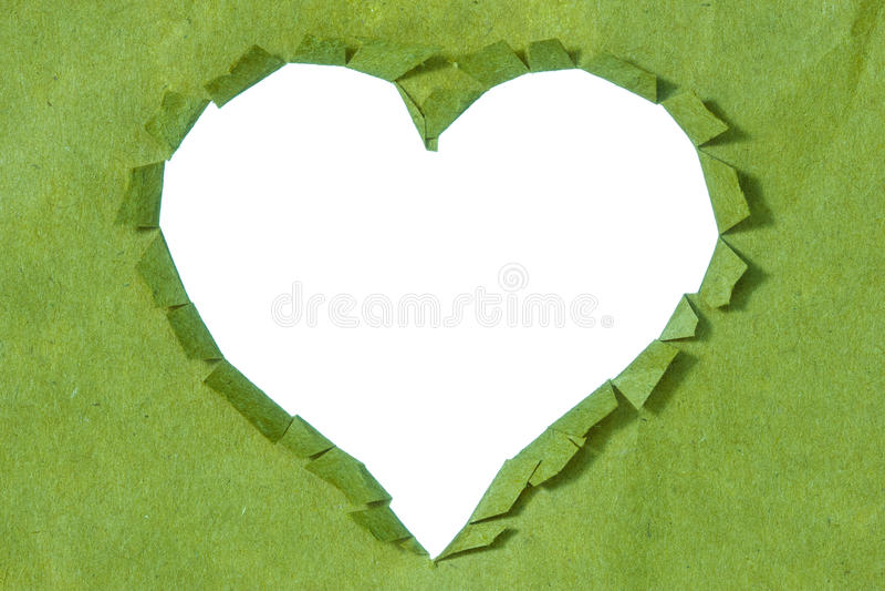Coeur déchiré dans un Livre vert image libre de droits