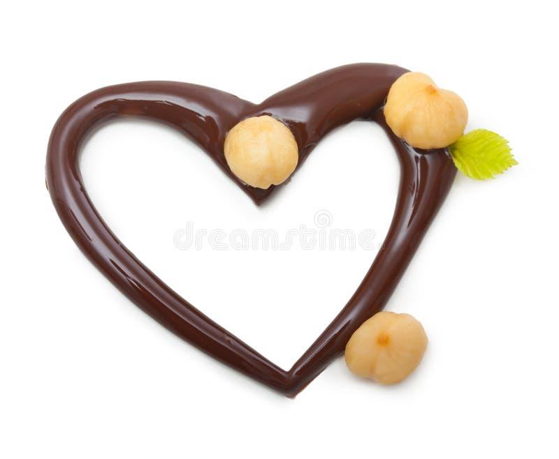 Coeur de chocolat avec des écrous photographie stock