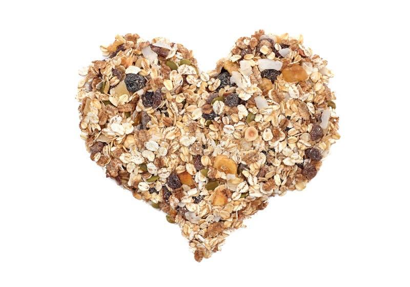 Coeur de grains de céréale de Muesli, de graines, de fruit et d'écrou image libre de droits