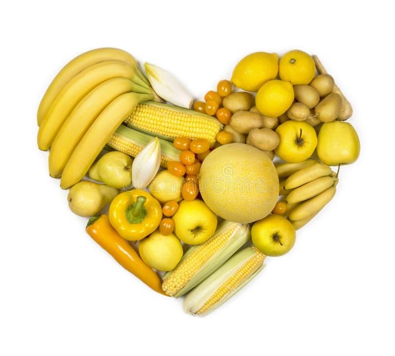 Coeur des fruits et légumes jaunes image libre de droits