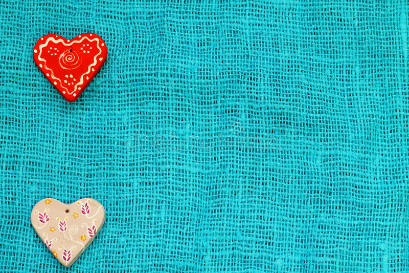 Coeur deux un jour du ` s de St Valentine de fond de turquoise photos libres de droits