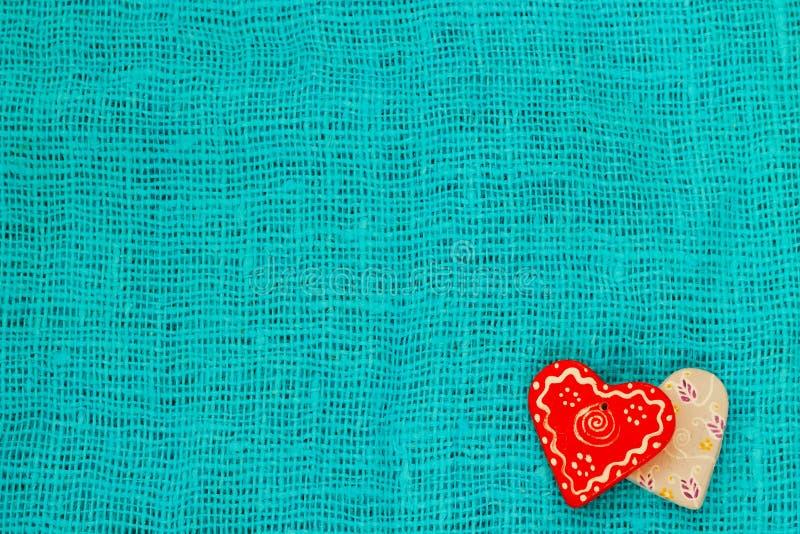 Coeur deux un jour du ` s de St Valentine de fond de turquoise photographie stock