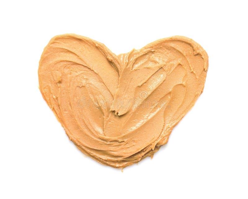 Coeur fait de beurre d'arachide photographie stock libre de droits