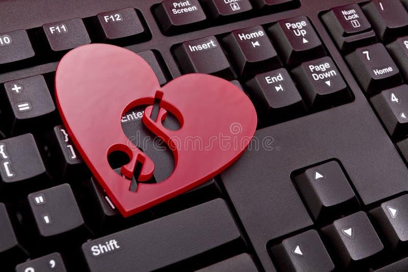 Coeur rouge avec un symbole dollar images libres de droits