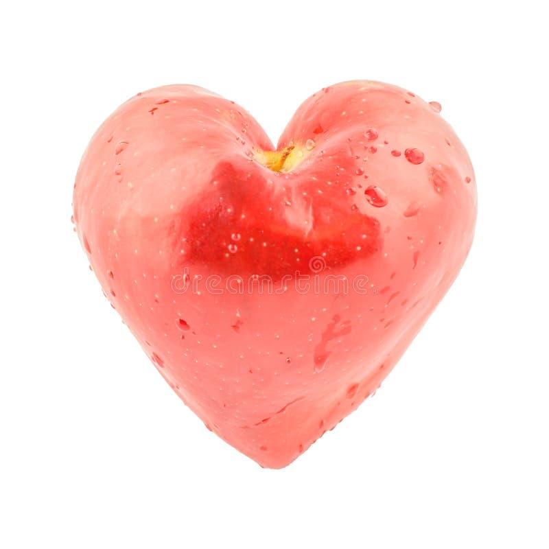Coeur rouge de pomme image stock