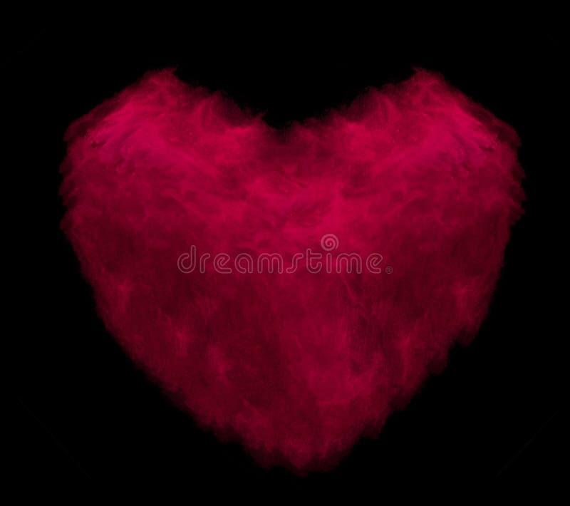 Coeur rouge fait en explosion de poudre d'isolement sur le fond noir images stock