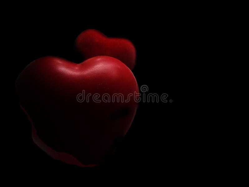 Coeur rouge sur le fond noir image stock