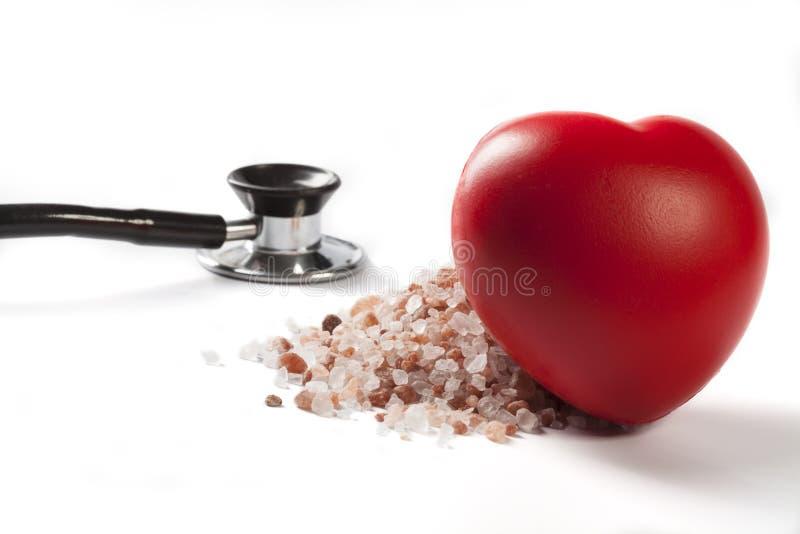 Coeur se penchant sur le sel photo stock