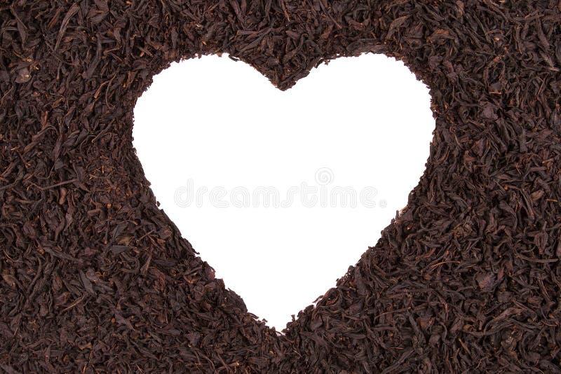 Coeur sur un fond de thé photo libre de droits