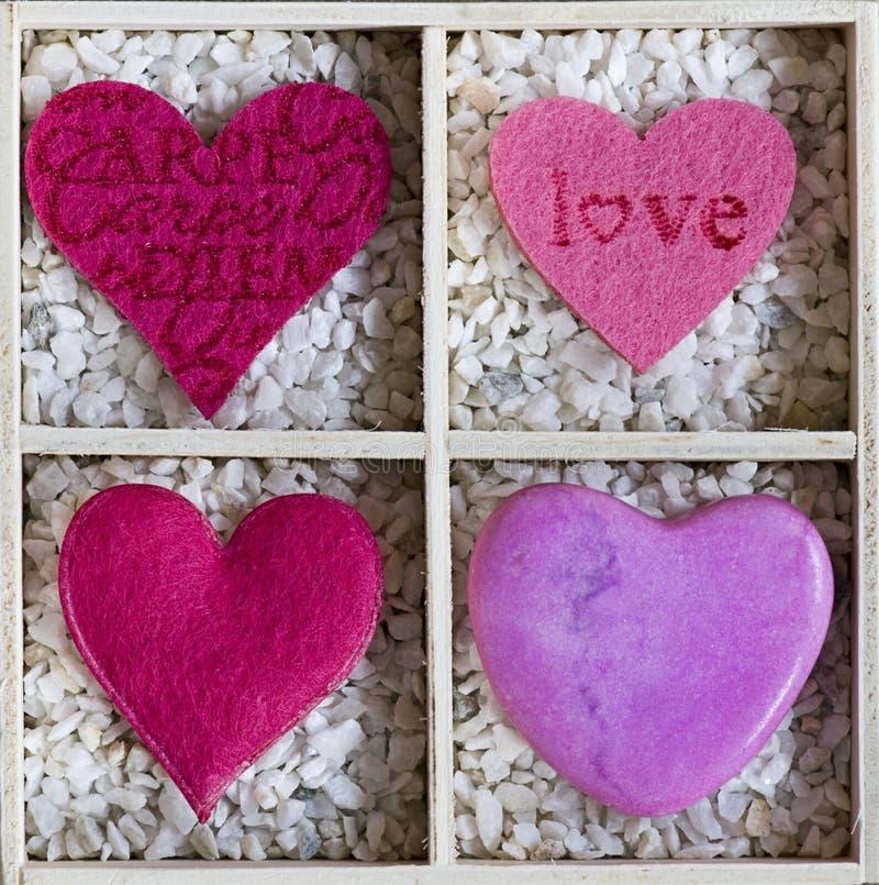 Coeurs dans un cadre images libres de droits